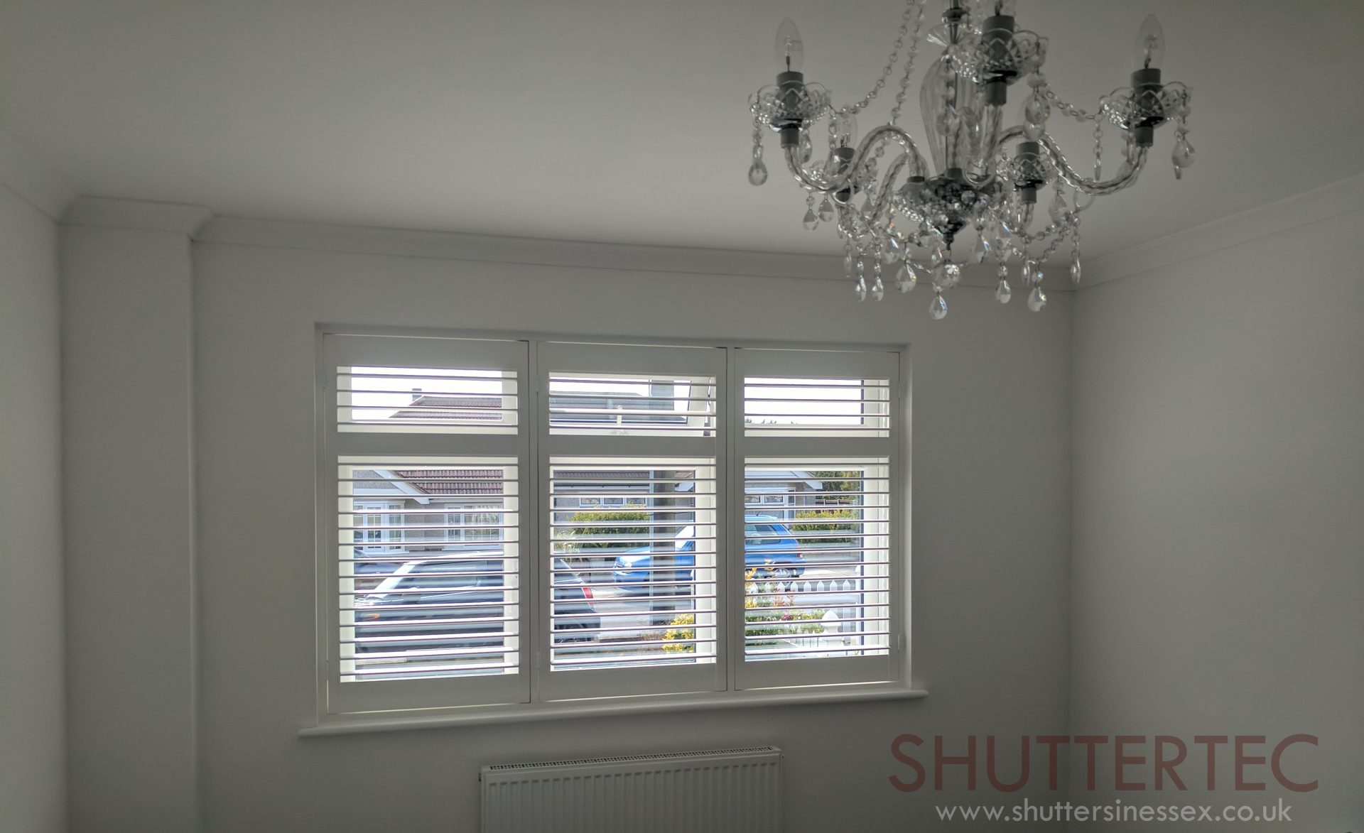White wood shutters