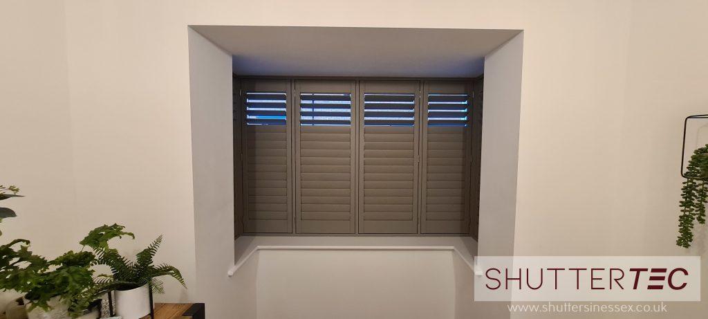 Grey shutters bay window