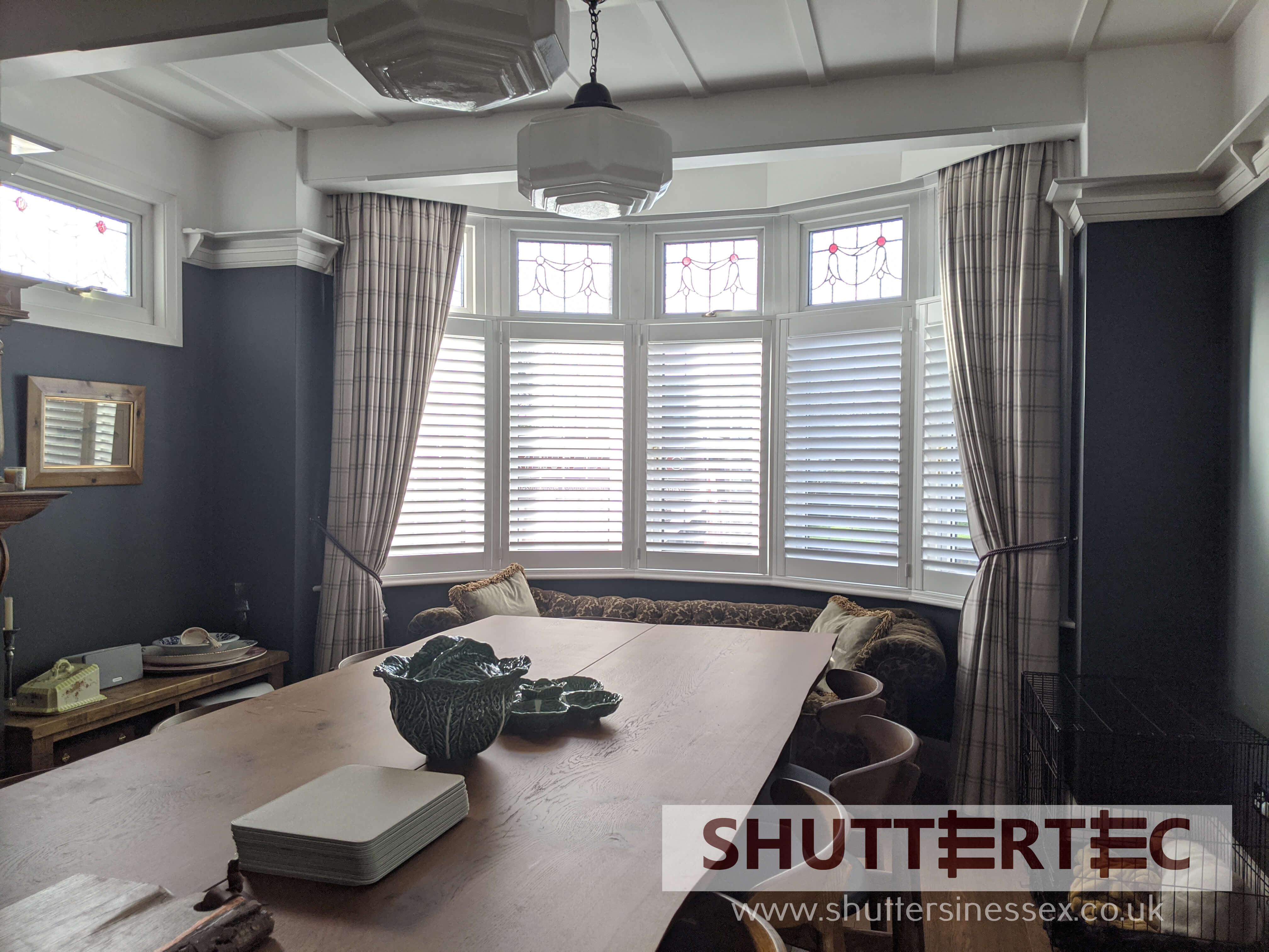 cafe style shutters on bay window