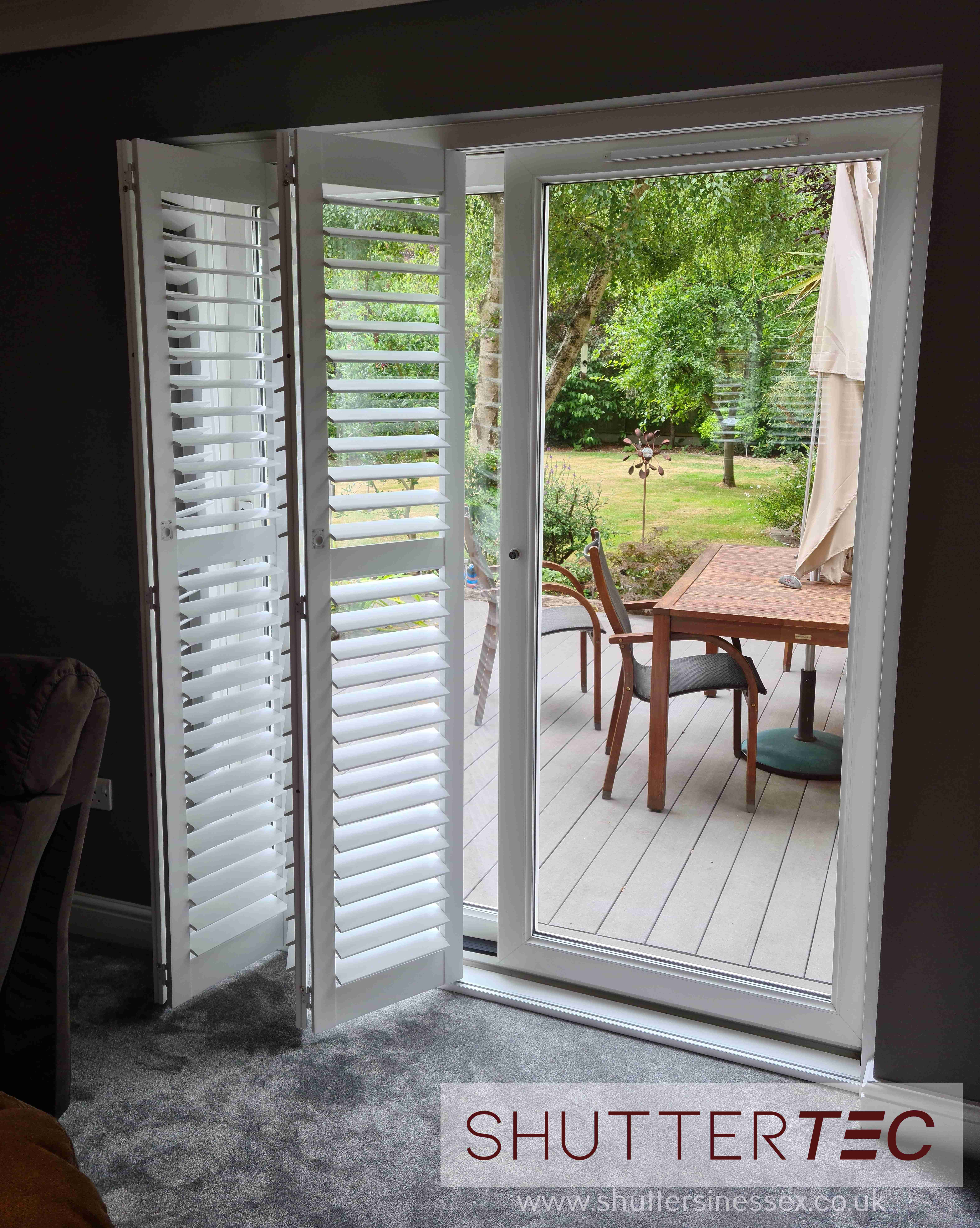 Tracked shutters for patio doors