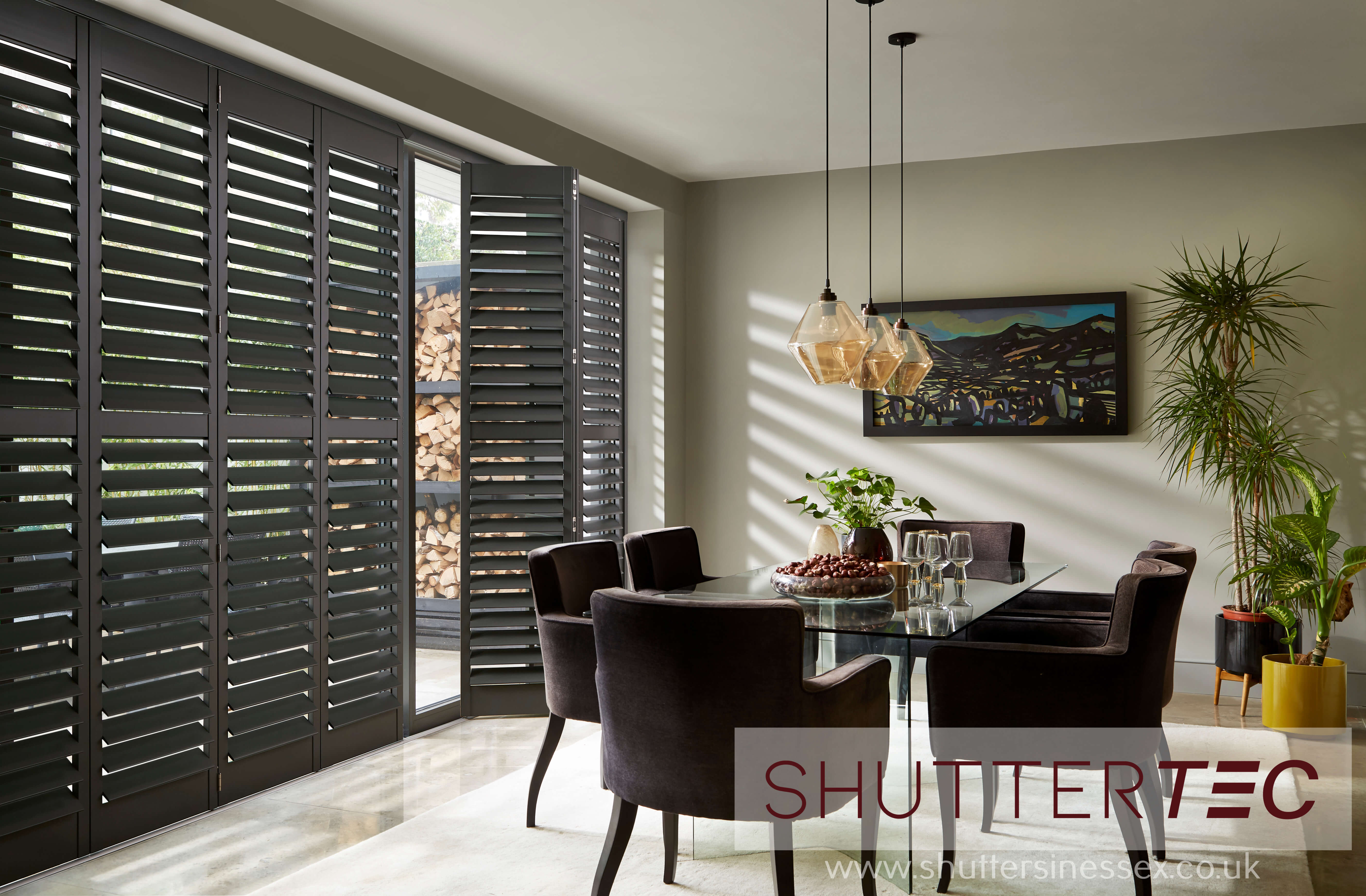 image of tracked shutters for blog entitled What's Better Blinds or Shutters