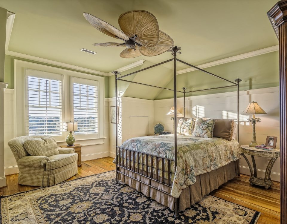 A furnished bedroom with window shutters